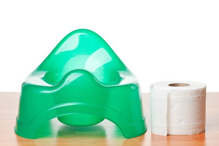 wee: green potty with toilet paper Stock Photo