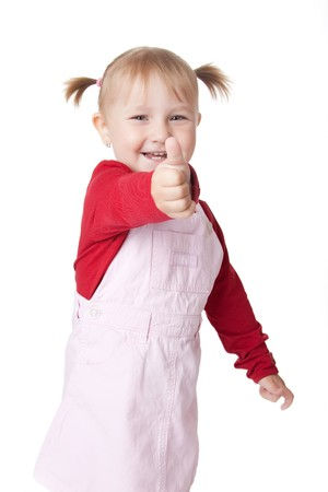 thumbup: the little girl with thumb up  Stock Photo