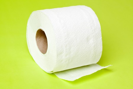 defecation: toilet paper on green background