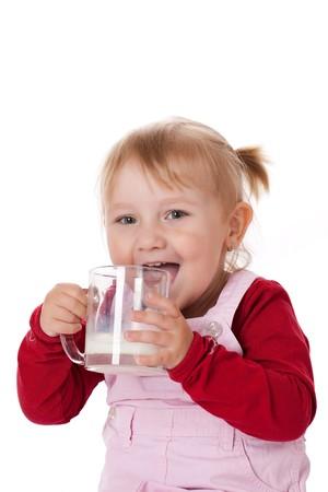 the little girl drinks milk photo