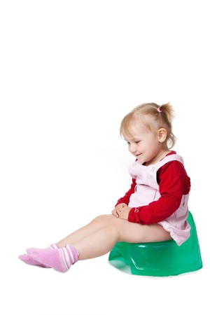 plait: the little girl sitting on potty