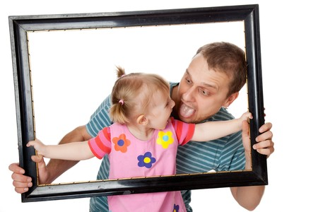 color photo: little girl with her dad in  wooden frame