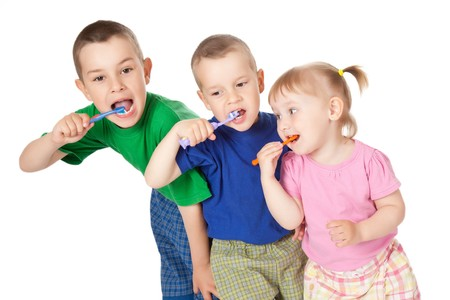 studio shot of children to brush his teeth photo