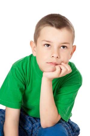 studio shot of pensive boy photo