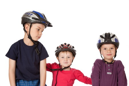 studio shot of childs in bicycle helmets photo