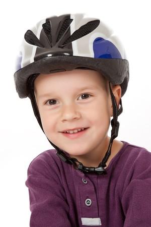 studio shot of boy in bicycle helmets photo