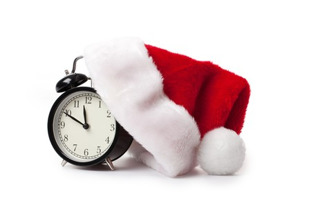 12 days of christmas: xmas red hat and alarm clock on white background Stock Photo