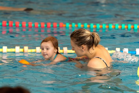mother and little daughter in the pool photo