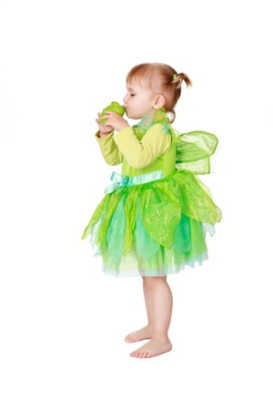 studio shot of little fairy with green frog photo