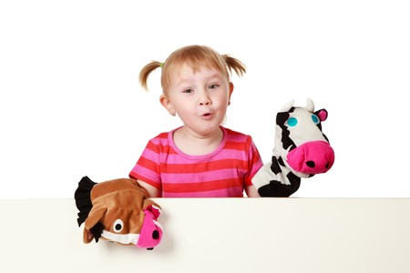 puppet theatre:  studio shot of little girl playing theater Stock Photo