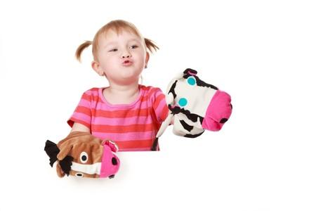 studio shot of little girl playing theater photo