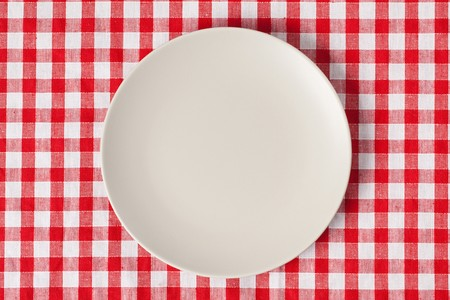 the plate on checkered table cloth photo
