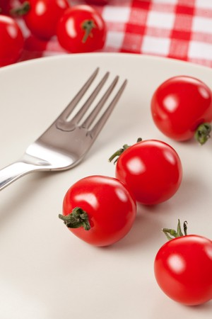 cherry tomatoes on plate photo