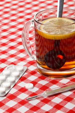 tea,pills and thermometer photo