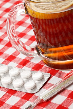 shot of tea,pills and thermometer Stock Photo - 7070296
