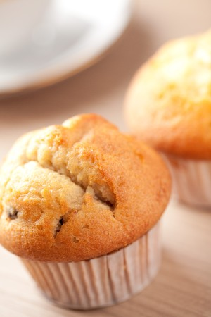sweet muffins on wooden table photo