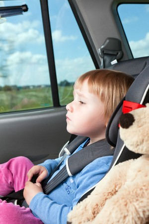 photo shot of child in car seat photo