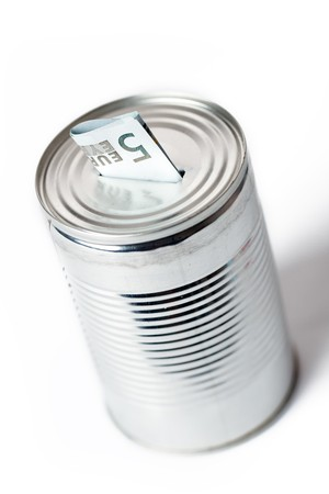 photo shot of paper currency in tin can photo