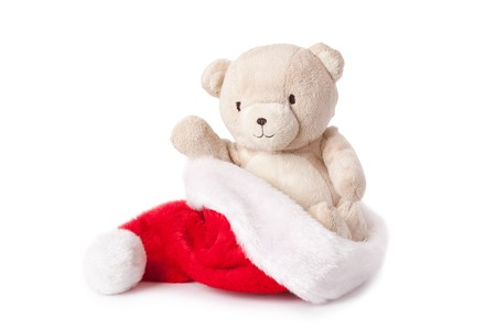 teddy bear and xmas cap on white background photo