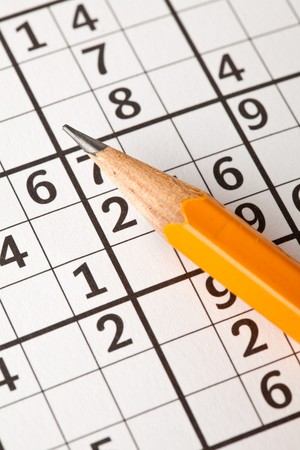 photo shot of sudoku game and pencil photo