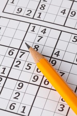 sudoku: photo shot of sudoku game and pencil Stock Photo