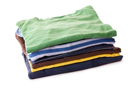 pile of clothes: pile of t-shirts on white background