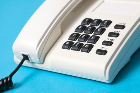 compiler: detail of phone on blue background Stock Photo