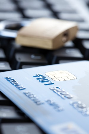 internet fraud: the credit card on computer keyboard