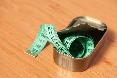 measuring tape in  tin can photo