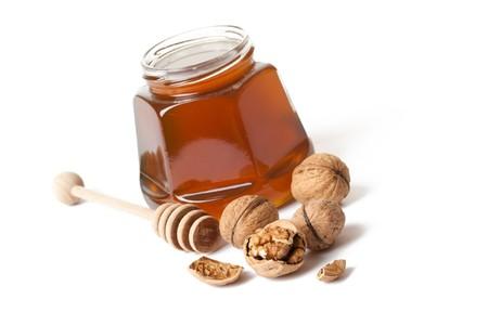 spice cake: honey and walnuts on white background