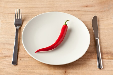 red chili pepper on a plate photo