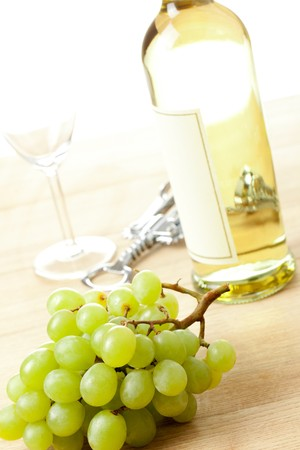 bootle:  grapes and white wine