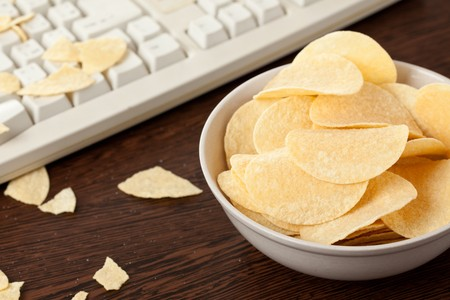 unhealthy snack:  chips and keyboard