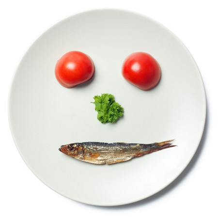 the face maked with vegetable and sprat photo