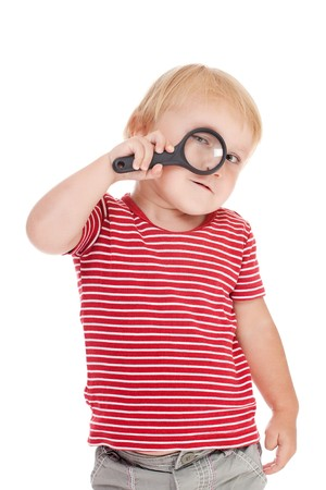 the little child with magnifier on her eye photo