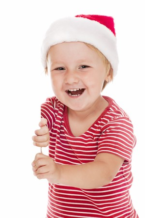 smiling child with xmas hat and white board photo