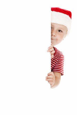 smiling child with xmas hat and white board Stock Photo - 7528329