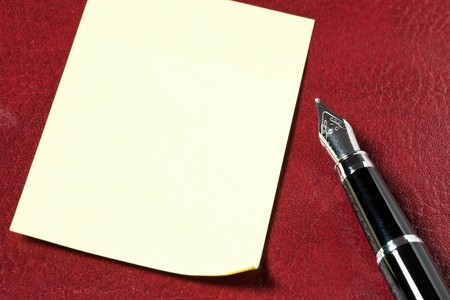 notepaper and black pen Stock Photo - 7529327