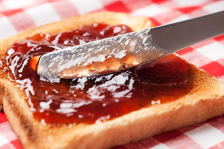 toast with jam on picnic tablecloth
