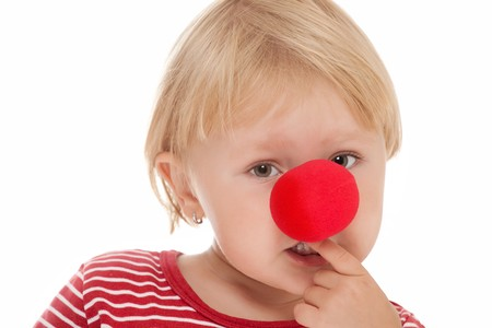 studio shot of child with clown nose photo