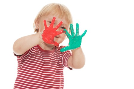 studio shot of little girl with colorful hands Stock Photo - 7565064