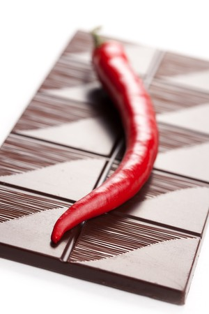 dark chili chocolate on white background photo