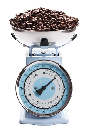 electronic balance: the kitchen scale with coffee beans Stock Photo
