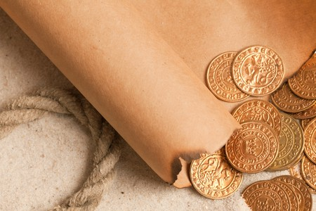 hidden success: the treasure map and golden coins Stock Photo