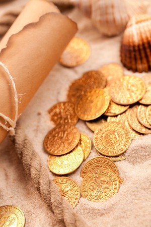 buried: the treasure map and golden coins Stock Photo