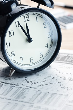 the alarm clock on financial graph.last moment Stock Photo - 7615077