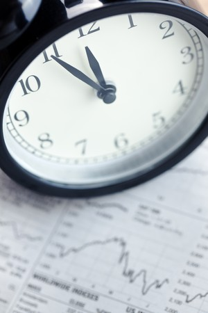 the alarm clock on financial graph.last moment Stock Photo - 7615051