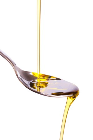 photo shot of olive oil poured into spoon Stock Photo - 7669257