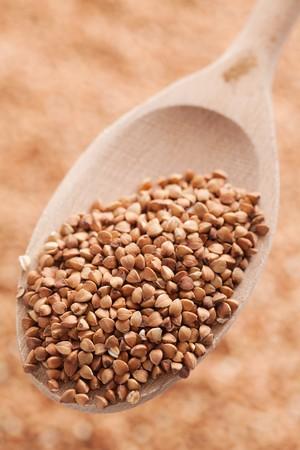 photo shot of buckwheat in wooden spoon photo