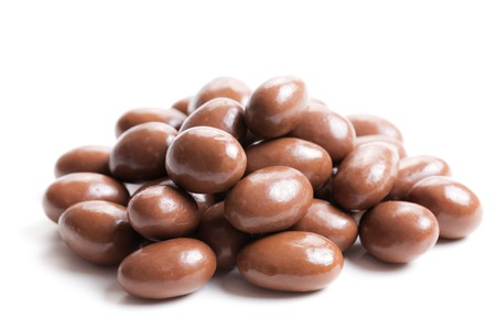 photo shot of almonds in chocolate